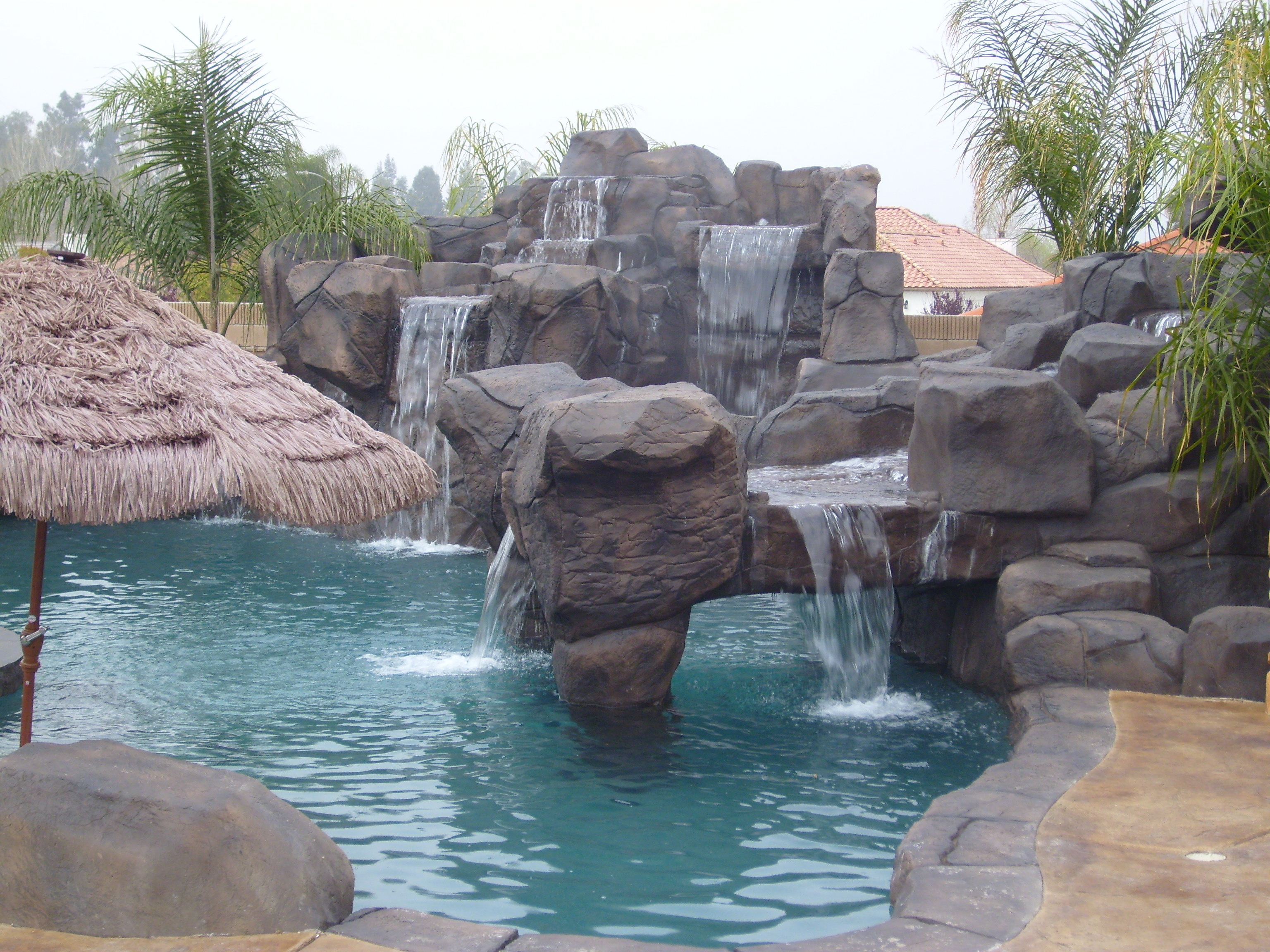 High End Custom Pool and Rock Waterfalls and Grotto